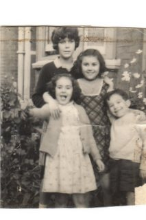 Me with my two sisters and brother William outside 14 College Avenue where the spooky event took place.