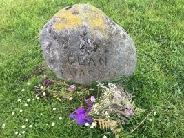 flowers laid at Clan Fraser cairn