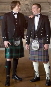 men in kilts laughing