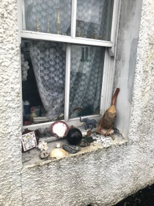 flotsam and jetsam collected on the fore shore and displayed on window ledges